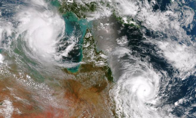 Cyclones Lam and Marcia Head Onshore