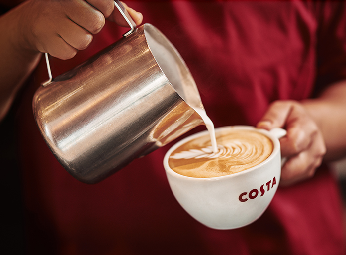 Costa Coffee flat white being poured