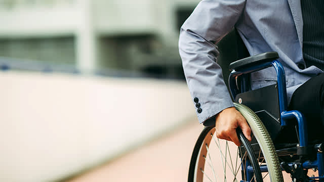 Man in wheelchair representing Siemens Ability and support