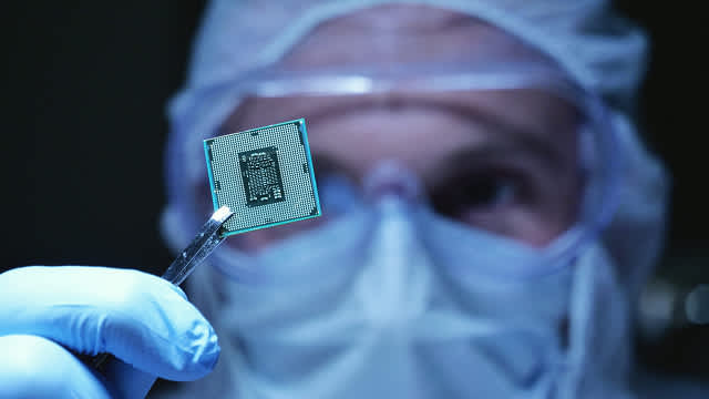 Image of a man holding  IC chip
