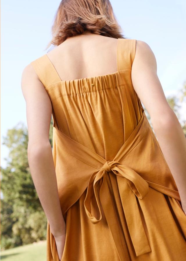 1d8a892fc3 Woman wearing Cuyana Dress in Mango Linen