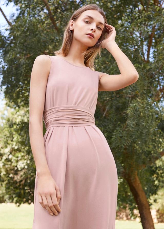 a60534f8aa Woman in Blush Cuyana Dress Woman in Blush Cuyana Dress. Woman wearing  Cuyana Dress in Mango Linen
