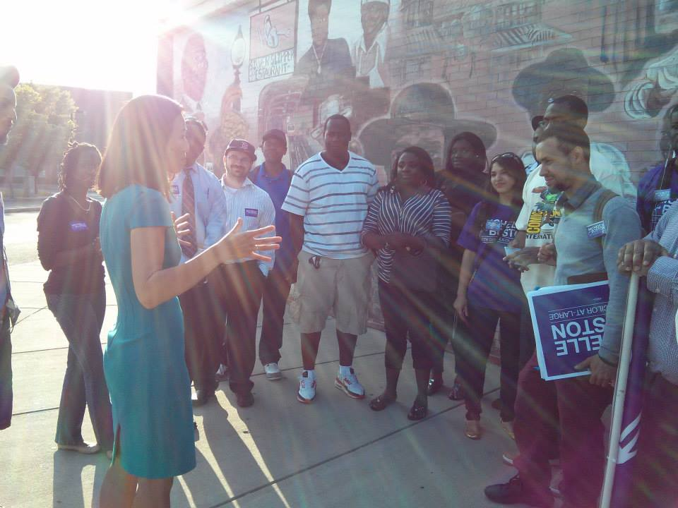 Michelle talks with a group of volunteers in Dudley Square on Juneteenth 2013.