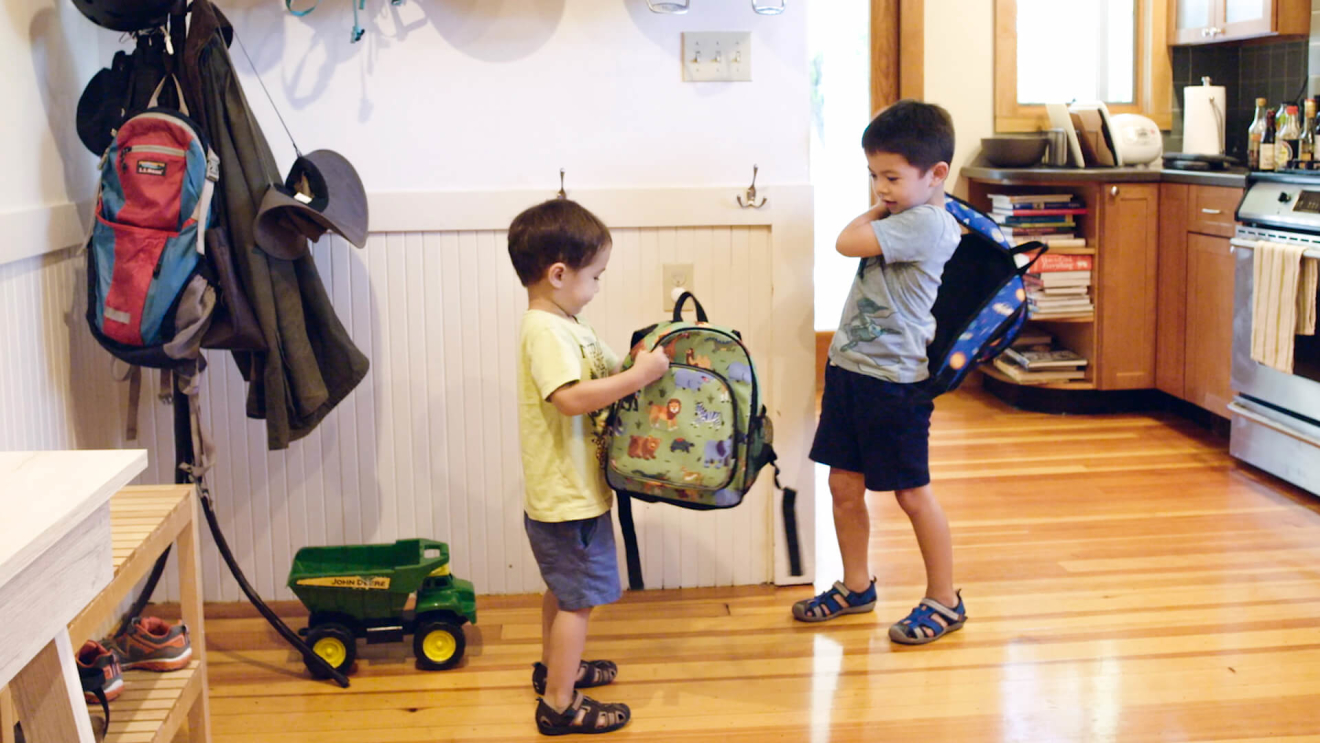 Michelle Wu's sons put on their backpacks for school.