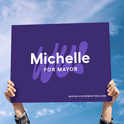 Supporter holding up Michelle for Mayor sign.