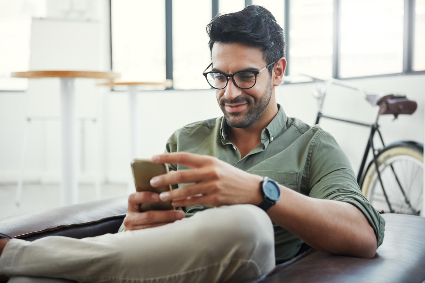 Man sitting at home using phone