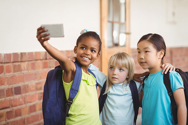 young students taking a selfie