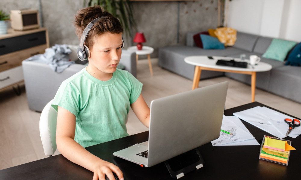 Child on a laptop wearing headphones