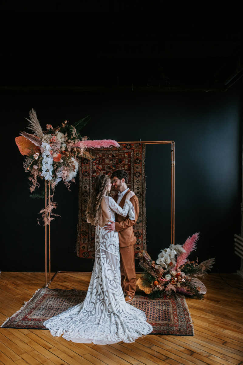 Couple posing in styled bohemian decor