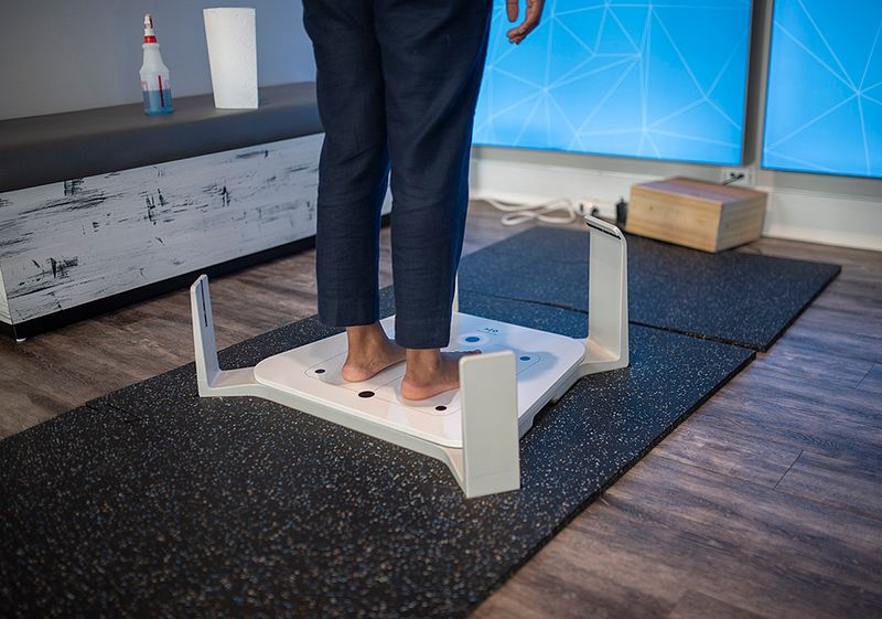 fleet foot foot scanner with someone standing in it waiting for their measurements to be taken
