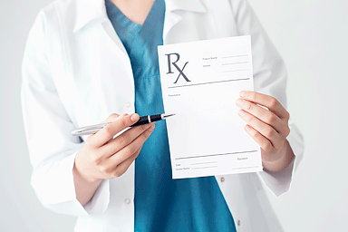 Doctor holding prescription pad