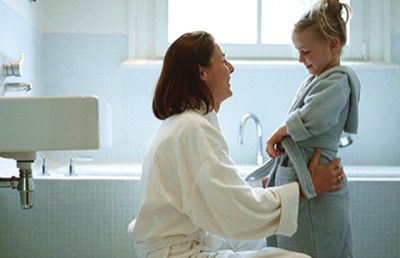 Adding colloidal oatmeal to your child's bath can help relieve dry, itchy skin. mother and child bath
