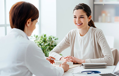 Woman consulting a dermatologist