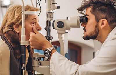 woman getting exam of cornea