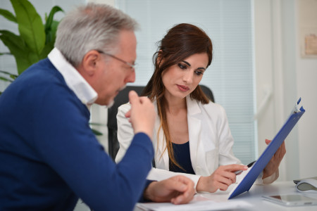 Doctor reviewing medical information with patient