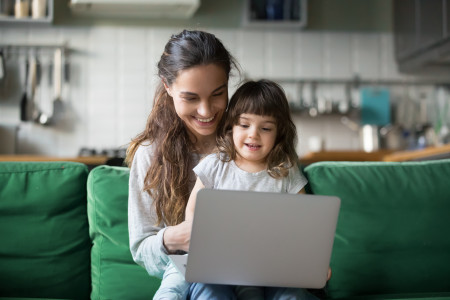 mother and young daughter on laptop