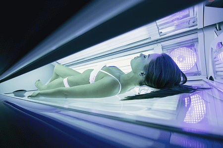Young woman using a tanning bed
