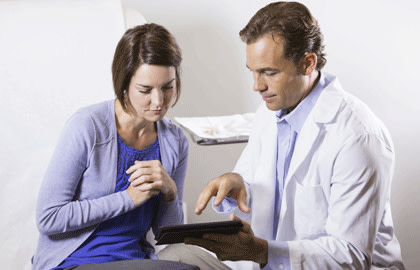 Physician consulting with female patient
