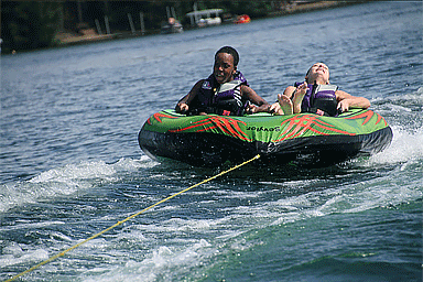 Children riding inside an inner tube during AAD's Camp Discovery