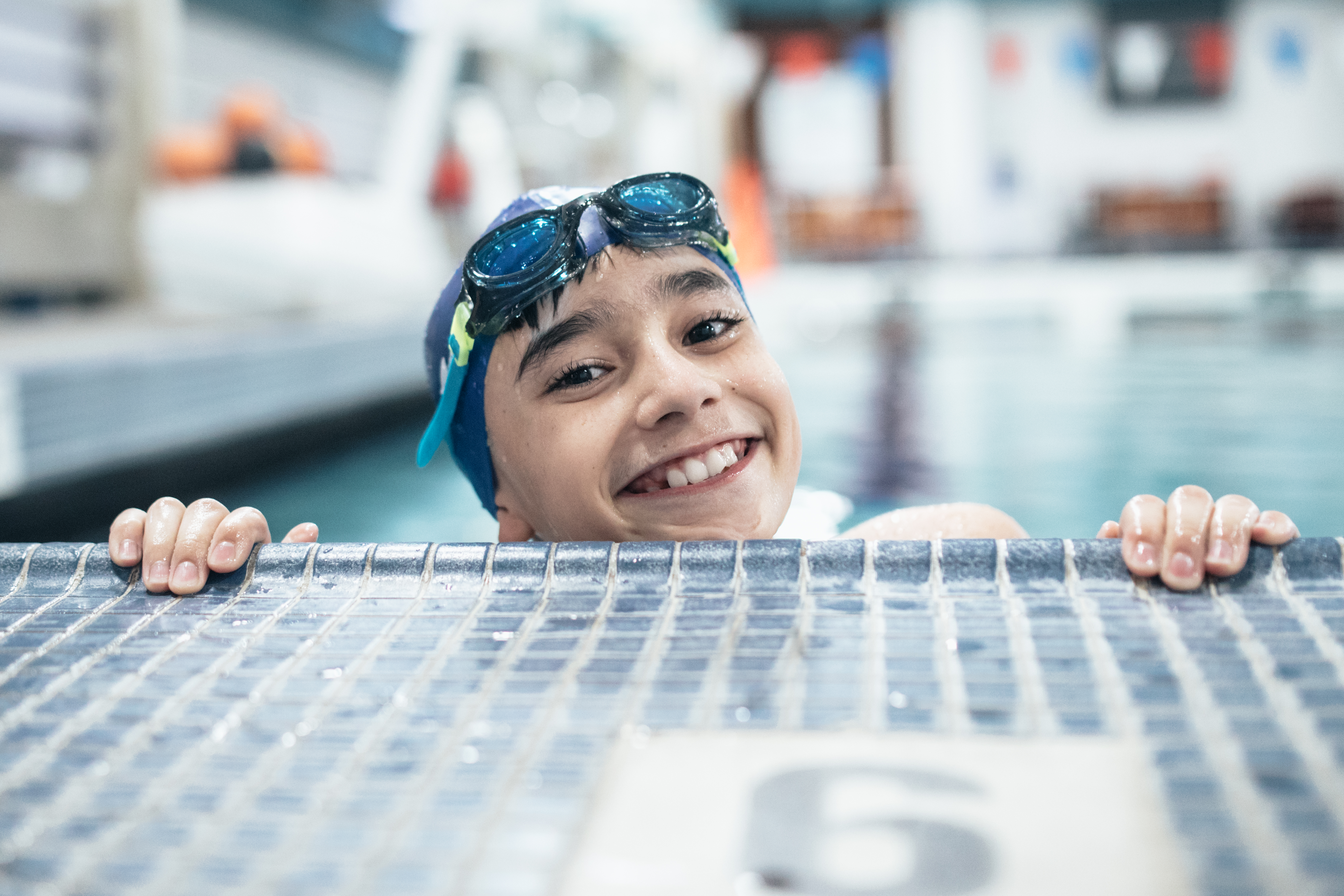 Boy swimming with swim cap