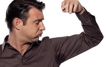 Man experiencing underarm sweat