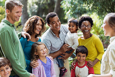 Multi-ethnic families at a park