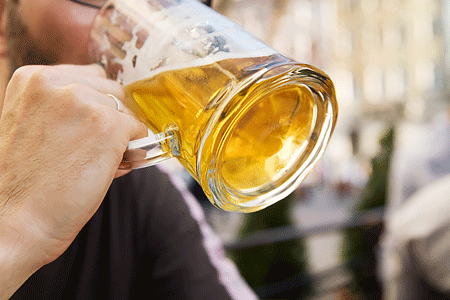 Man drinking beer from a beer mug