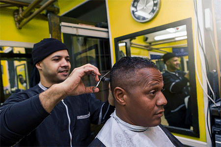 African American man getting a hair cut