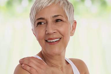 Smiling mature woman looking over her shoulder