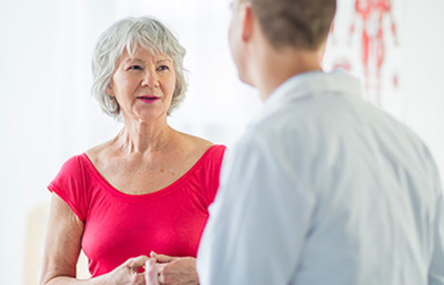 Older woman consulting a dermatologist
