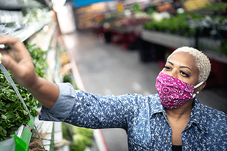 Woman wearing face mask while shopping