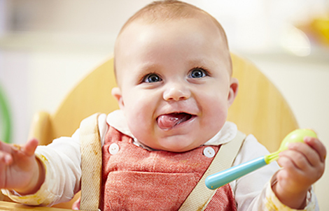 Happy baby. Find out if something on your child's own body could be triggering the eczema.