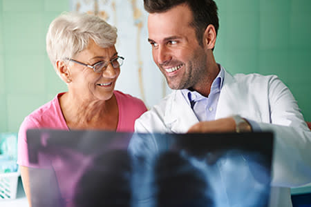 Male doctor reviewing x-ray results with female patient