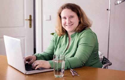 Happy woman at laptop