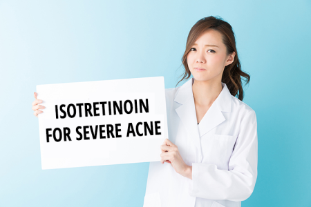 Doctor showing sign with Isotretinoin severe acne