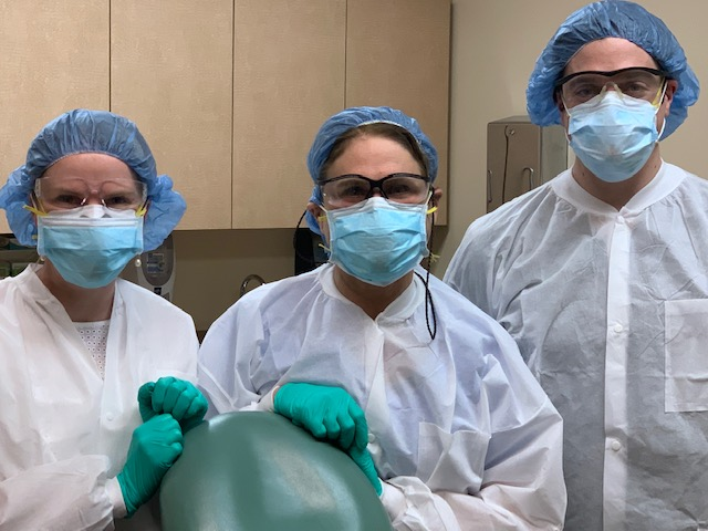 Authors Ashley Decker, MD, Naomi Lawrence, MD, and Henry Heaton, MD wearing PPE.