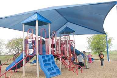 Shade structure protecting playground equipment