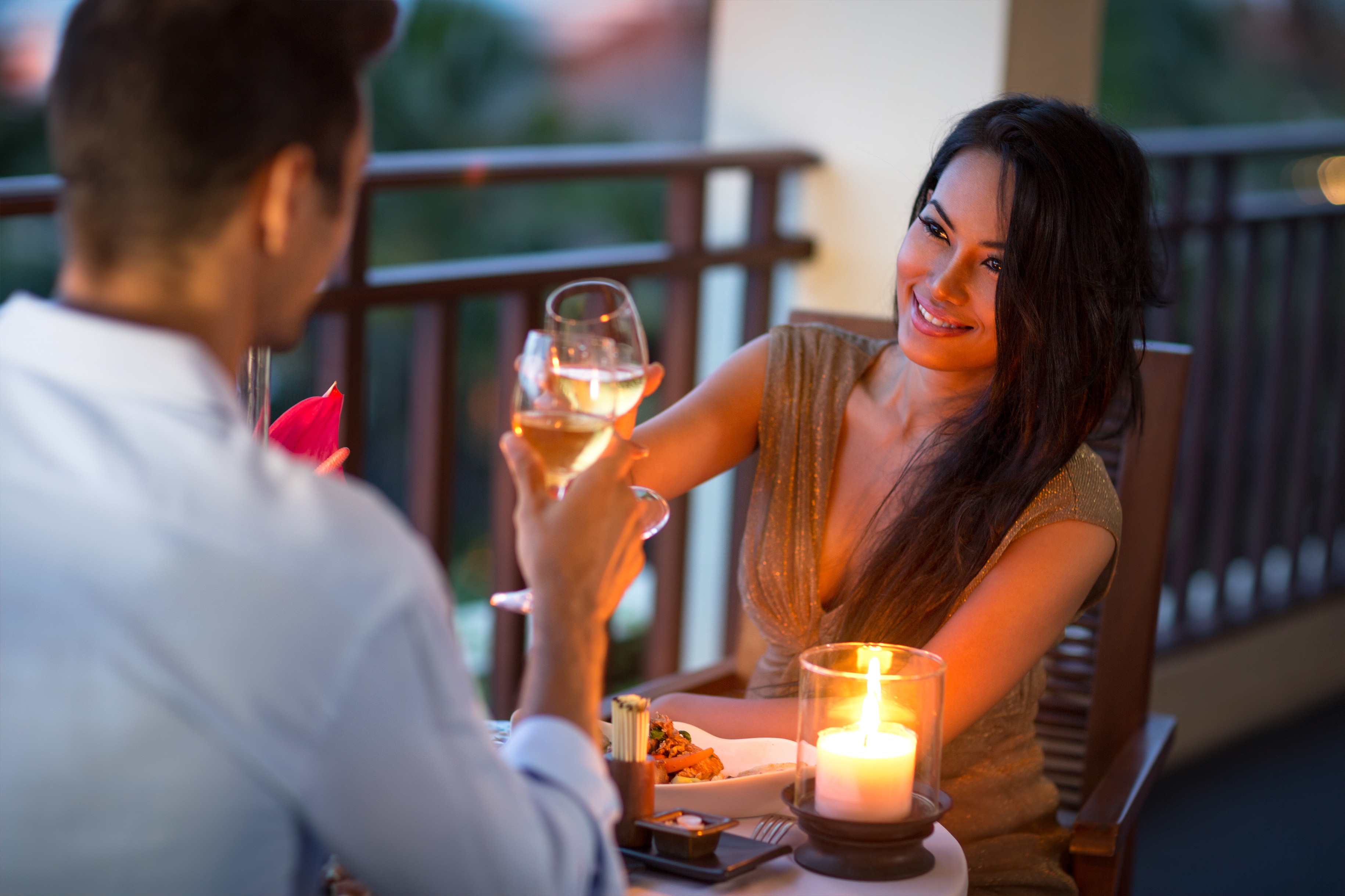 Couple having intimate dinner for two on the terrace of summer evening