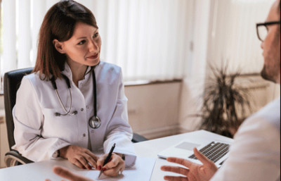 Primary care physician with patient