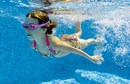 child swimming. Pool chemicals can dry the skin.