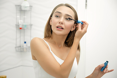 Woman applying eye liner