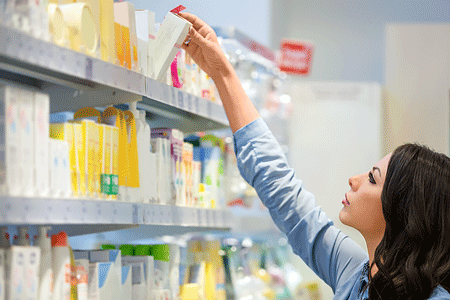 Woman shopping for skin care products in department store
