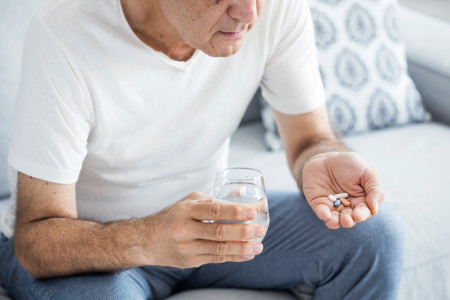 older man taking pills