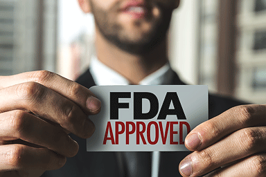 Man holding an FDA approved sign