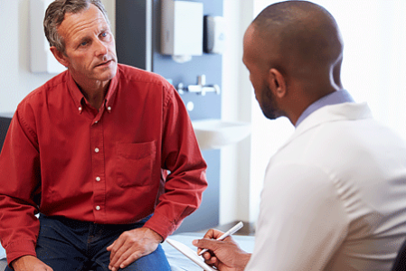 Male patient meeting with male dermatologist for medical treatment