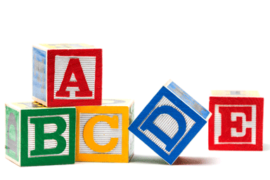 Wooden ABCDE play blocks on white background