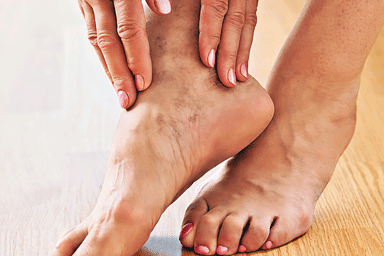 Close up of mature woman hands touching her lower legs and painful ankle