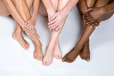 Legs of young women with diverse skin tones