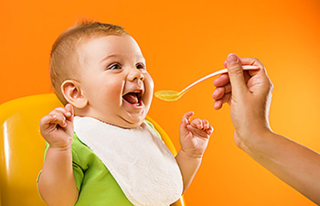 happy baby eating