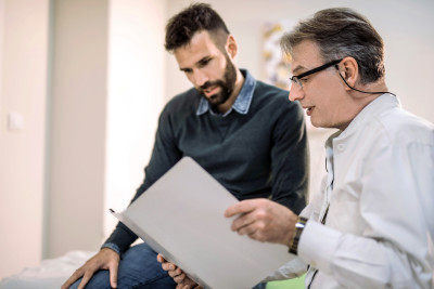 doctor and patient reviewing medical record